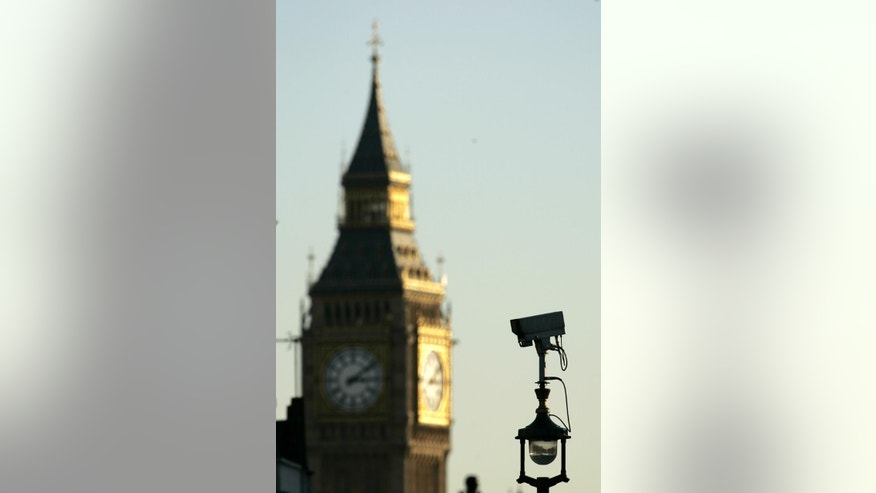 "FILE - In this Nov. 2, 2006, file photo, a CCTV (Closed Circuit Television) camera, with the backdrop of the clock tower containing Big Ben, keeps a watch in central London. After four home-grown suicide bombers killed 52 London commuters on July 7, 2005, Prime Minister Tony Blair vowed that Britain would stop at nothing to defeat terrorism. ""Let no one be in any doubt,"" he said. ""The rules of the game are changing."" Since the Sept. 11 attacks in the United States four years earlier, Britain had made its anti-terrorism powers among the toughest in the Western world. Now they became tougher still. ""What 7/7 did was it made people realize that the threat was internal as well as external,"" said David Anderson, Britain's official reviewer of terrorism legislation.  (AP Photo/Akira Suemori, File)"