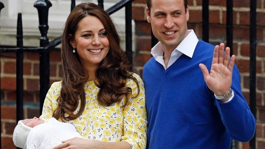 Saturday, May 2, 2015: Kate, Duchess of Cambridge, and Prince William smile as they carry their newborn baby Princess Charlotte from St. Mary's Hospital in London, following the birth.