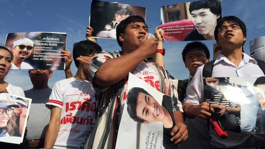 Supporters of 14 detained students protest outside the military court in Bangkok, Thailand, Tuesday, July 7, 2015. Fourteen detained student activists went before a military court in Thailand on Tuesday in a case that has attracted international calls for their release and criticism of the military junta's strict controls on freedom of speech and assembly. The university students, 13 men and one woman, were arrested June 26 on charges of sedition and violating the junta's ban on political gatherings for leading a peaceful anti-coup rally in Bangkok.(AP Photo/Penny Yi Wang)