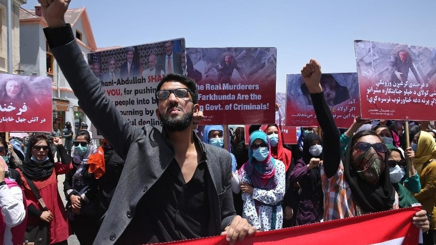 A man chants slogans during a protest held by the Solidarity Party of Afghanistan for 27 year-old Farkhunda, who was beaten to death by a mob months ago, at the site of the attack in Kabul, Monday, July 6, 2015. More than one hundred gathered to demand justice for the woman who was killed on March 19 outside one of the capital's most famous mosques. (AP Photo/Massoud Hossaini)