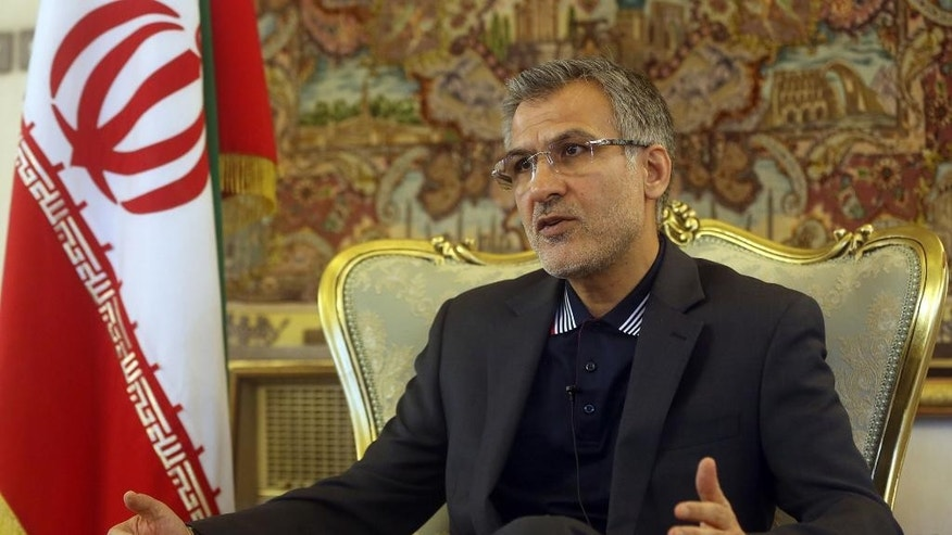 In this Saturday, July 4, 2015 photo, Tehran's ambassador to Kabul, Mohammad Reza Bahrami, speaks  during an interview with The Associated Press at the Iranian embassy in Kabul, Afghanistan. As Iran and global powers move toward a nuclear agreement, Brahimi said a deal easing crippling economic sanctions would also benefit security and development in Afghanistan, his country's war-torn neighbor. Bahrami also said Iran would be prepared to help fight the Islamic State group if its presence in Afghanistan grows into a real and regional threat. (AP Photo/Massoud Hossaini)