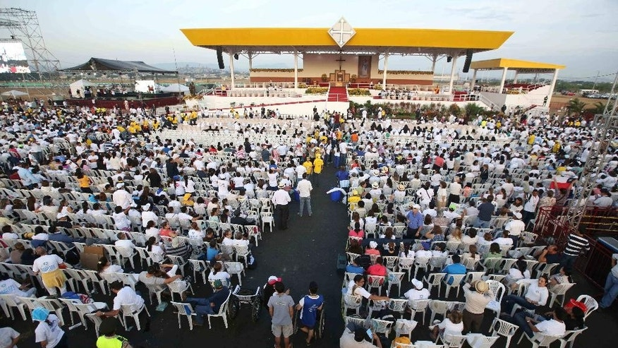 "People wait for the arrival of Pope Francis to celebrate a Mass at Samanes Park in Guayaquil, Ecuador, Monday, July 6, 2015. The ""pope of the poor"" returned to Spanish-speaking South America for the first time as pontiff Sunday, stressing the need to protect the poor and the environment from exploitation and to foster dialogue among all sectors of society. (AP Photo/Fernando Vergara)"