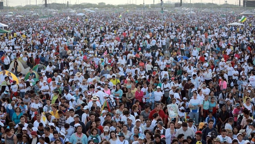 Faithful wait for the arrival of Pope Francis to celebrate a Mass at the Samanes Park in Guayaquil, Ecuador, Monday, July 6, 2015. Francis travels to the Ecuadorean port of Guayaquil on Monday for a Mass expected to draw more than 1 million people, as Latin America's first pontiff tours his home continent bringing a message of compassion for the weak and respect for an ailing planet. (AP Photo/Fernando Vergara)