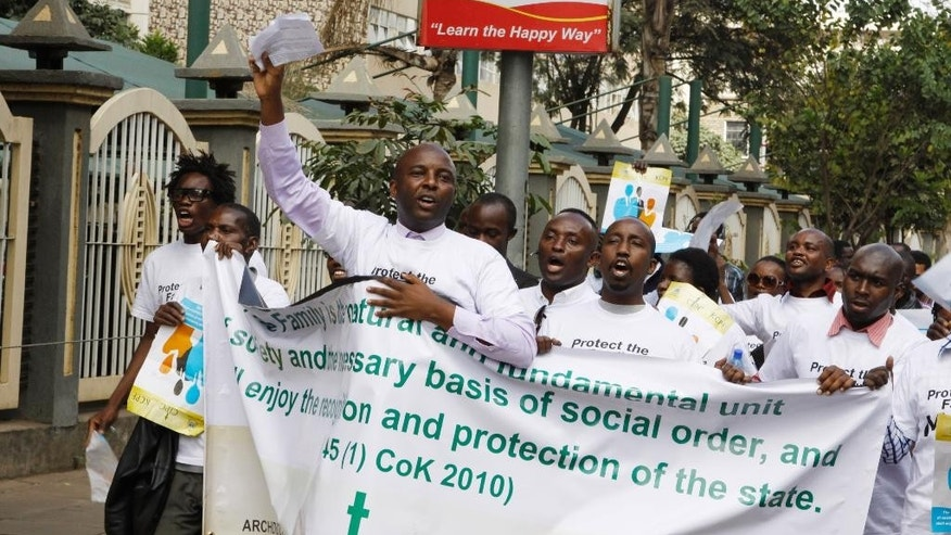 Members of various Christian groups march during a protest against gay and same sex unions in Nairobi, Kenya, Monday, July 6, 2015. A demonstration against homosexuality in Kenya has fizzled after attracting only a handful of protesters. The demonstration by about 35 people Monday was called by the Evangelical Alliance of Kenya and timed to coincide with the visit later this month of U.S. President Barack Obama. The group is calling on Obama not to advocate for gay rights during his visit to Africa July 24-28. (AP Photo/ Khalil Senosi)