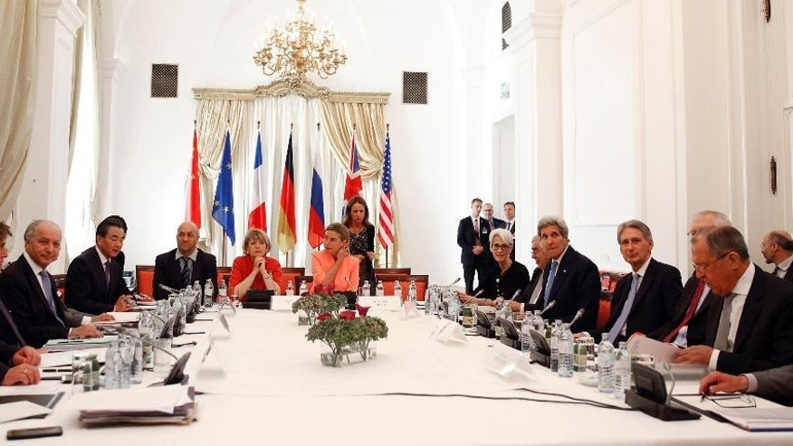July 6, 2015 - German Foreign Minister Frank-Walter Steinmeier, left, French Foreign Minister Laurent Fabius, 3rd left, Chinese Foreign Minister Wang Yi, 4th left, European Union High Representative for Foreign Affairs and Security Policy Federica Mogherini, centre row, right, U.S. Secretary of State John Kerry, 4th right, British Foreign Secretary Philip Hammond, 3rd right, and Russian Foreign Minister Sergey Lavrov, right, meet in Vienna,  ahead of Tuesday's deadline for a final agreement to end a 12-year-old nuclear dispute.