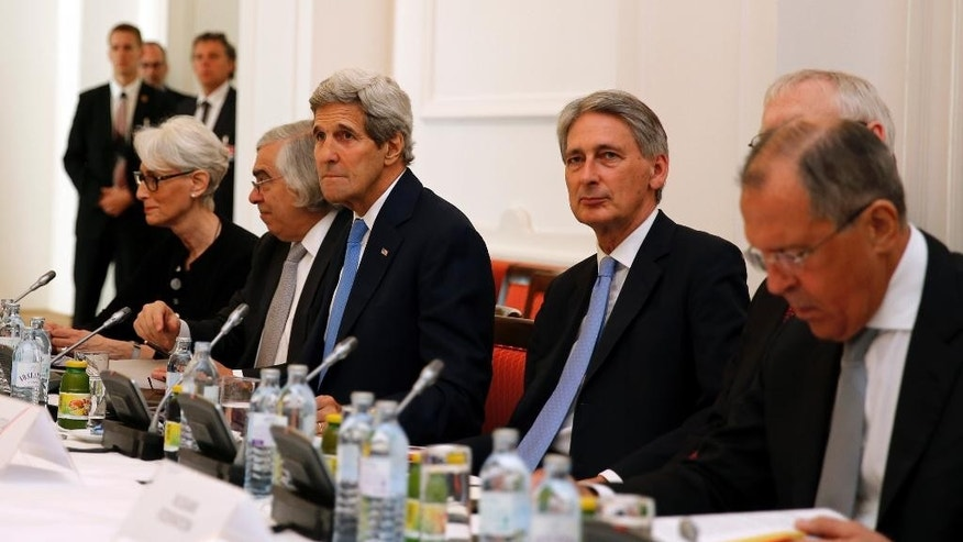 U.S. Secretary of State John Kerry, 3rd left, British Foreign Secretary Philip Hammond, 2nd right, and Russian Foreign Minister Sergey Lavrov, right, meet with foreign ministers from China, Germany and France at an hotel in Vienna, Austria Monday, July 6, 2015. Iran's foreign minister said on Monday some differences still remained between Iran and six powers over the country's disputed nuclear programme ahead of Tuesday's deadline for a final agreement to end a 12-year-old dispute.  (Carlos Barria/Pool Photo via AP)