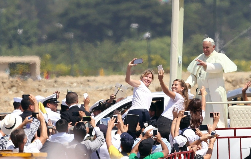 July 6, 2015 - Pope Francis waves to the crowd as he rides in the popemobile through Samanes Park, where he celebrated Mass, in Guayaquil, Ecuador.