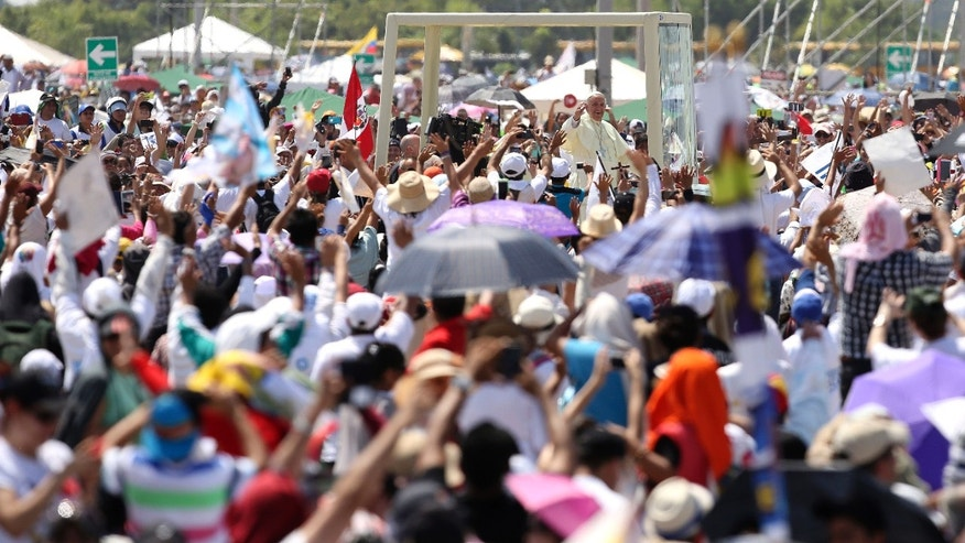 July 6, 2015 - Pope Francis aboard the popemobile after arriving in Samanes Park to celebrate Mass, in Guayaquil, Ecuador. Many in the crowd of hundreds of thousands had spent the night and walked for miles to celebrate Mass with the pontiff.