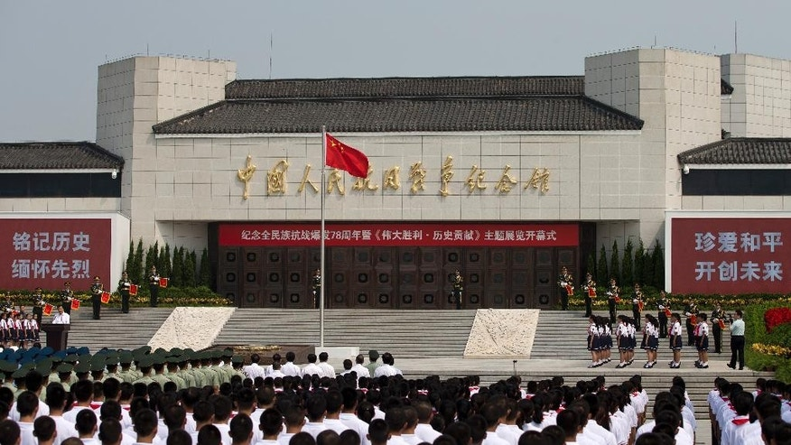 "Liu Yunshan, left, a member of the Standing Committee of the Political Bureau of the Communist Party of China, delivers a speech at the opening ceremony of the Museum of the War of Chinese People's Resistance Against Japanese Aggression commemorating the World War II victory over Japan, in Beijing Tuesday, July 7, 2015. Soldiers and children stood in silence outside the museum at the opening ceremony for the ""Great Victory and Historical Contribution"" exhibition on the 78th anniversary of the Marco Polo Bridge Incident. A clash at the Marco Polo Bridge in 1937 is regarded as the first battle of the second Sino-Japanese war, which lasted until Japan's defeat by the Allies in 1945. (AP Photo/Andy Wong)"
