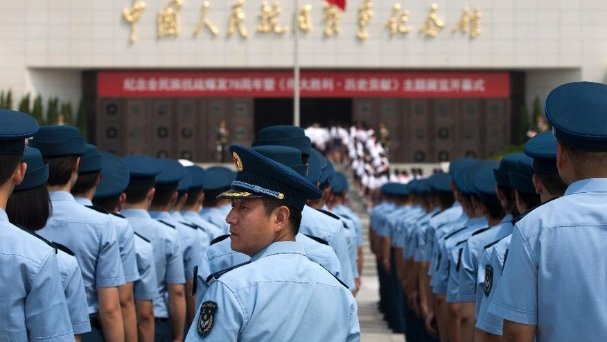 "Soldiers from the People's Liberation Army (PLA) Air Force division stand in lines during the opening ceremony of the Museum of the War of Chinese People's Resistance Against Japanese Aggression commemorating the World War II victory over Japan, in Beijing Tuesday, July 7, 2015. Soldiers and children stood in silence outside the museum at the opening ceremony for the ""Great Victory and Historical Contribution"" exhibition on the 78th anniversary of the Marco Polo Bridge Incident. A clash at the Marco Polo Bridge in 1937 is regarded as the first battle of the second Sino-Japanese war, which lasted until Japan's defeat by the Allies in 1945. (AP Photo/Andy Wong)"