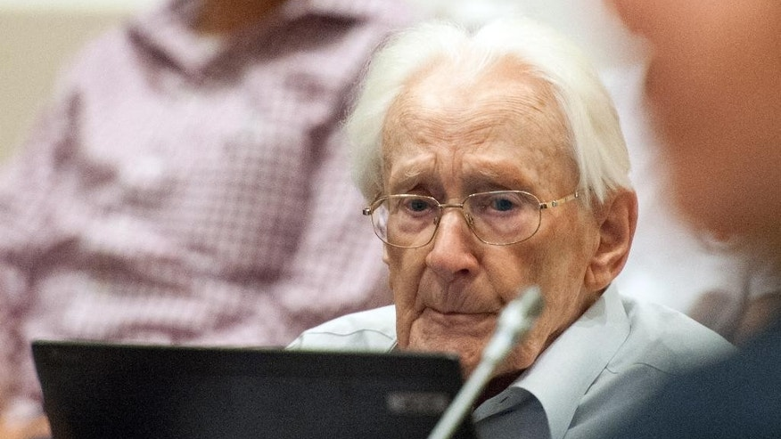 Former SS officer Oskar Groening , 94, sits in the courtroom in Lueneburg , northern Germany, Tuesday, July 7, 2015. Groening is charged with 300,000 counts of accessory to murder on allegations he helped the Auschwitz Nazi death camp function by sorting cash and valuables seized from Jews. (Philipp Schulze/Pool Photo via AP)