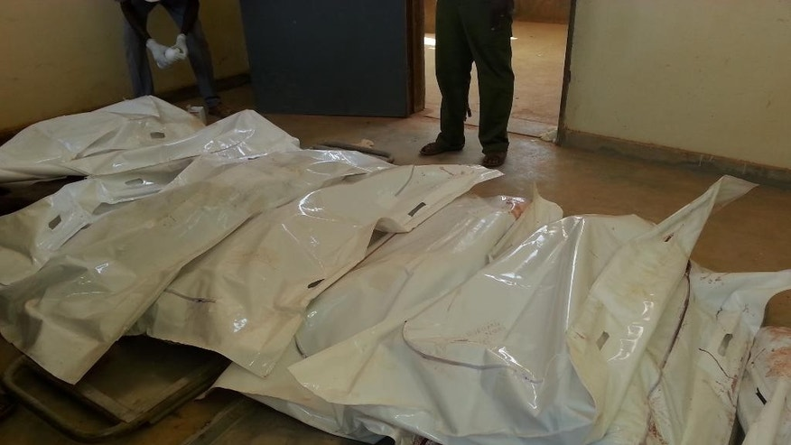 Body bags are seen in Mandera, Kenya, Tuesday, July 7, 2015. At least 14 people were killed in an attack early Tuesday in the country's north by al-Shabab, Islamic extremist rebels from neighboring Somalia, a Kenyan official said. Eleven people were also wounded in the attack which took place in Soko Mbuzi village in Mandera County near Kenya's border with Somalia, said Mandera County Commissioner Alex Nkoyo. (AP Photo)