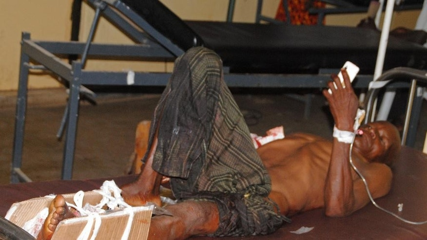 A man lays injured following a bomb blast,  receives treatment at a hospital in Zaria, Nigeria, Tuesday, July 7, 2015. A bomb blast in Nigeria's northern university town of Zaria killed 25 people Tuesday including a 2-year-old toddler, the Kaduna state governor reported, Tuesday, the latest in a string of deadly bombing and shooting attacks attributed to the Boko Haram Islamic extremist group.(AP Photo)