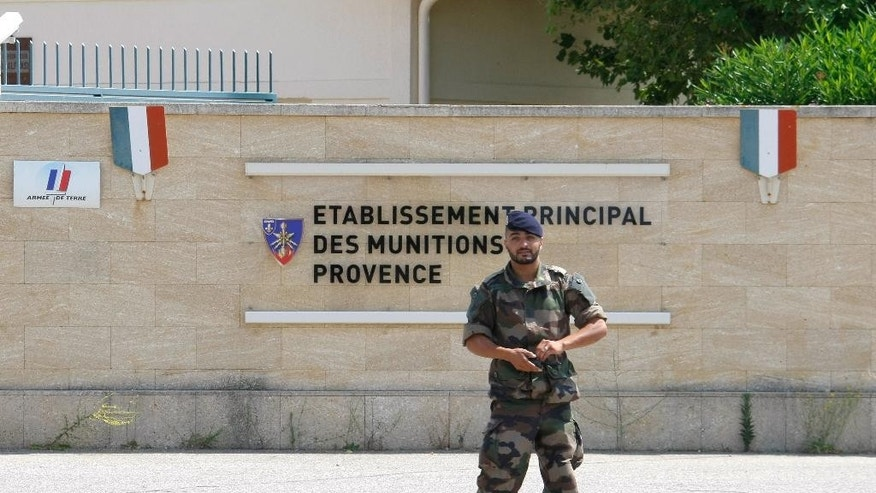 A soldier walks outside the weapons stocks military base in Miramas , southern France, Tuesday, July 7, 2015.  French authorities are investigating the theft of roughly 200 detonators plus grenades and plastic explosives from the military site.  The break-in comes as France has strengthened its security measures after two deadly attacks by extremists this year. (AP Photo/Claude Paris)