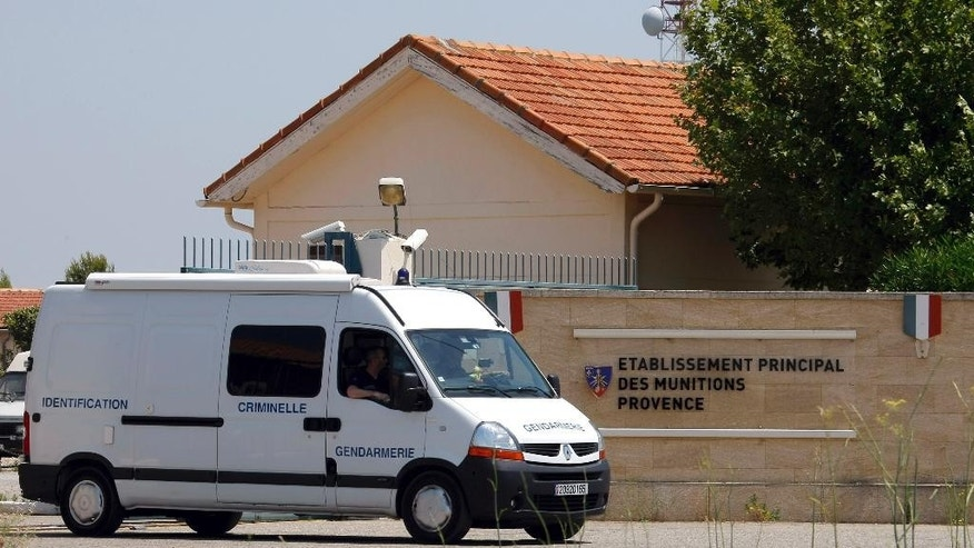 A criminal investigation van of the French Gendarmerie leaves a military base in Miramas , southern France, Tuesday, July 7, 2015.  French authorities are investigating the theft of roughly 200 detonators plus grenades and plastic explosives from the military site.  The break-in comes as France has strengthened its security measures after two deadly attacks by extremists this year. (AP Photo/Claude Paris)