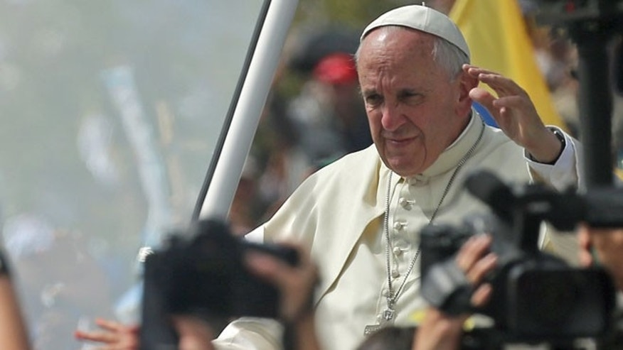 July 7: Pope Francis waves as he arrives to celebrate Mass at Bicentennial Park in Quito, Ecuador.