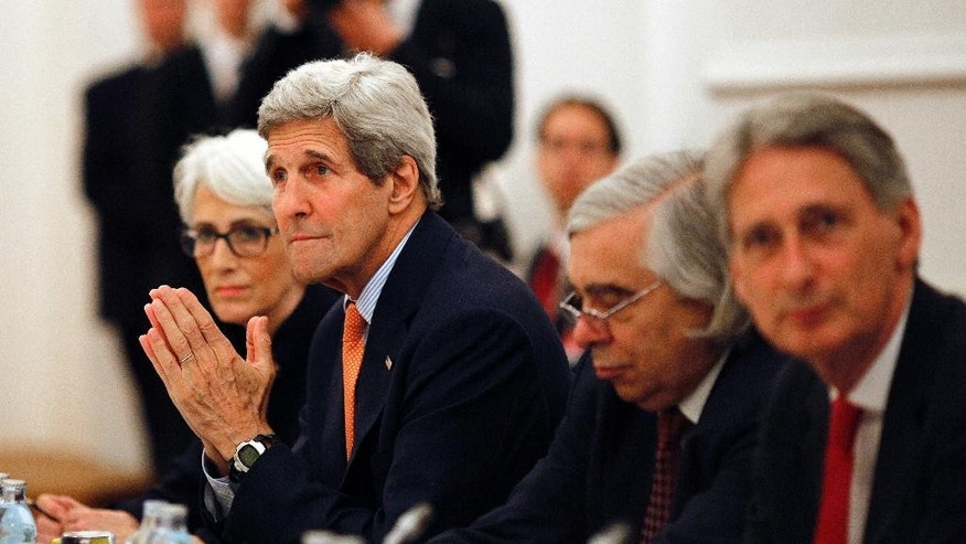 U.S. Secretary of State John Kerry meets with foreign ministers of Germany, France, China, Britain, Russia and the European Union at a hotel in Vienna, Austria, Tuesday, July 7, 2015. Iran nuclear talks were in danger of busting through their second deadline in a week Tuesday, raising questions about the ability of world powers to cut off all Iranian pathways to a bomb through diplomacy, and testing the resolve of U.S. negotiators to walk away from the negotiation as they've threatened. (Carlos Barria/Pool photo via AP)