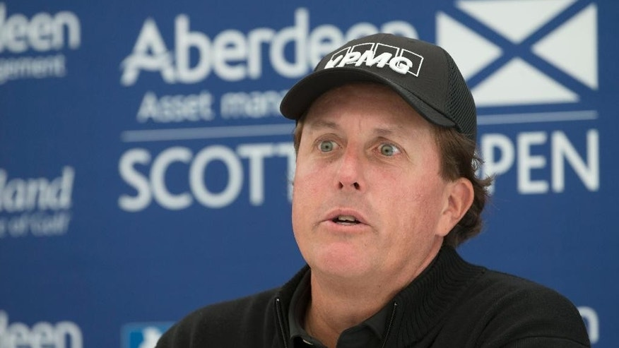 "US golfer  Phil Mickelson answers questions from the media during a preview day ahead of the Scottish Open at Gullane Golf Club, Gullane Scotland Wednesday July 8, 2015. Five-time major champion Phil Mickelson has refused to comment on allegations linking him to an illegal gambling operation, saying he had got used to being an ""object to be discussed."" Speaking Wednesday ahead of the Scottish Open, Mickelson says ""the fact is I'm comfortable enough with who I am as a person that I don't feel I need to comment on every little report that comes out."" (Kenny Smith/PA via AP) UNITED KINGDOM OUT"