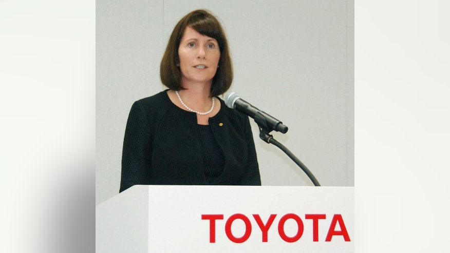 Julie Hamp, a former highest ranking woman executive of Toyota Motor Corp., leaves Harajuku police station after being released, in Tokyo Wednesday, July 8, 2015. American woman Hamp, who was arrested June 18 on suspicion of bringing oxycodone, a narcotic pain killer, was released from custody Wednesday. Japanese media reports say Hamp will not face charges. (Yosuke Mizuno/Kyodo News via AP) JAPAN OUT, CREDIT MANDATORY