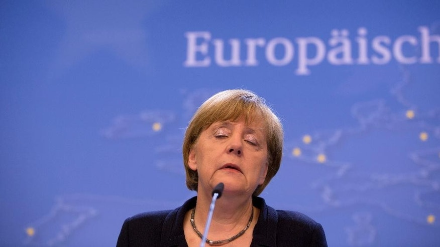 German Chancellor Angela Merkel listens to questions during a final media conference after an emergency summit of eurozone heads of state and government at the EU Council building in Brussels on Tuesday, July 7, 2015. EU leaders have called for a full EU summit to take place on Sunday, July 12, 2015 to continue discussion on the Greek crisis. (AP Photo/Virginia Mayo)