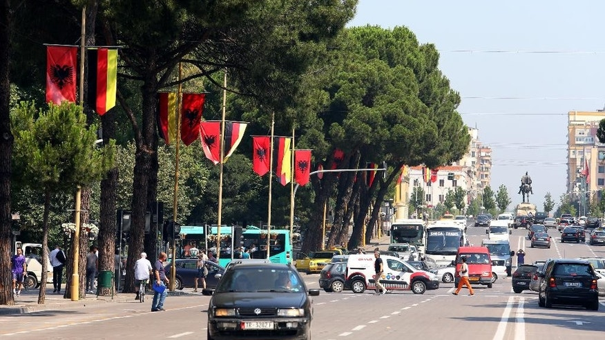 Albanian and German flags decorate Tirana's main boulevard Martyrs of the Nation ahead of the visit of German Chancellor Angela Merkel, Wednesday, July 8, 2015. Merkel is on a Balkan trip to Albania, Serbia and Bosnia, which are all looking forward to becoming European Union members one day. (AP Photo/Hektor Pustina)