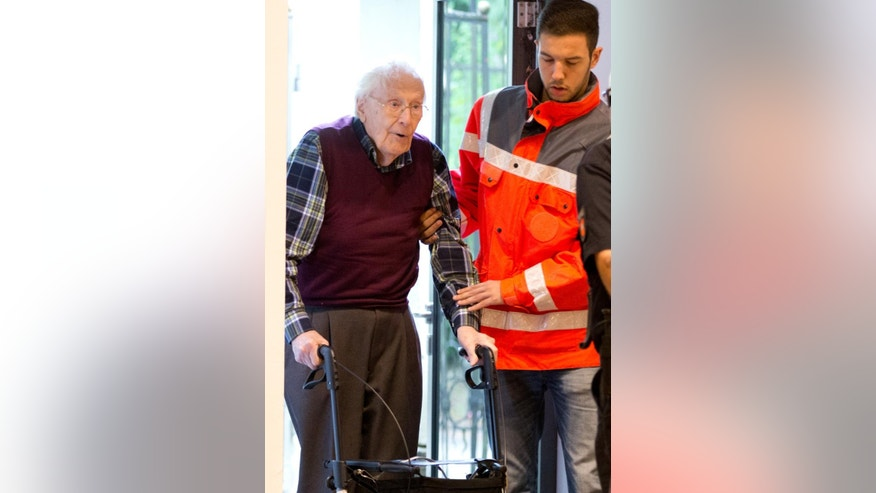 Former SS officer Oskar Groening, left, arrives at  a courtroom in Lueneburg, northern Germany, Wednesday July 8, 2015.   German prosecutors  sought a 3½-year prison sentence for the  94-year-old former SS sergeant who served at the Auschwitz death camp in Nazi-occupied Poland, saying his role there made him an accessory to murder. (Christian Charisius/Pool Photo via AP)