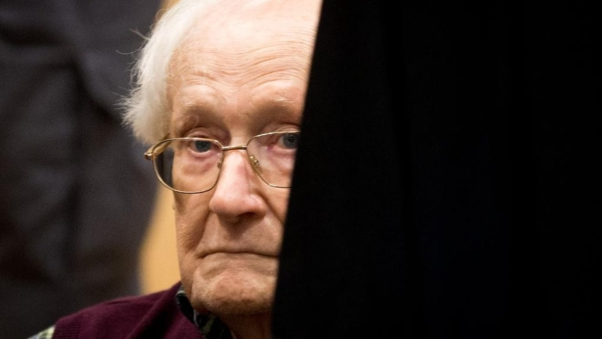 Former SS officer Oskar Groening  waits in a court room in Lueneburg, northern Germany, Wednesday July 8, 2015.   German prosecutors  sought a 3½-year prison sentence for the  94-year-old former SS sergeant who served at the Auschwitz death camp in Nazi-occupied Poland, saying his role there made him an accessory to murder. (Christian Charisius/Pool Photo via AP)
