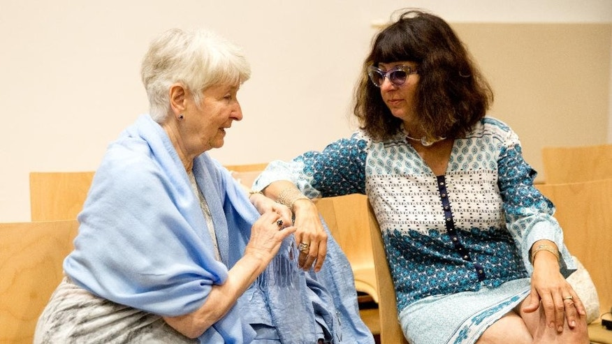 Former prisoner of Auschwitz concentration camp and plaintiff Hedy Bohm , left, and her daughter Vicky Bohm  wait in the courtroom  for the trial of former German SS officer Oskar Groening  in Lueneburg, northern Germany, Wednesday July 8 2015 Groening is charged with 300,000 counts of accessory to murder on allegations he helped the Auschwitz Nazi death camp function by sorting cash and valuables seized from Jews.  German prosecutors sought a 3½-year prison sentence for the  94-year-old former SS sergeant who served at the Auschwitz death camp in Nazi-occupied Poland, saying his role there made him an accessory to murder.  ( Christian Charisius/Pool Photovia AP)