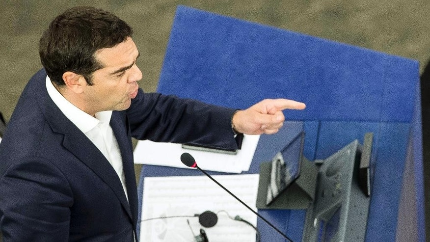 Greek Prime Minister Alexis Tsipras  delivers his speech at the European Parliament in Strasbourg, eastern France, Wednesday, July 8, 2015.  Tsipras says his country wants a deal that will mean a definitive end to Greece's protracted financial crisis, and that last Sunday's referendum result does not mean a break with Europe. (AP Photo/Jean-Francois Badias)