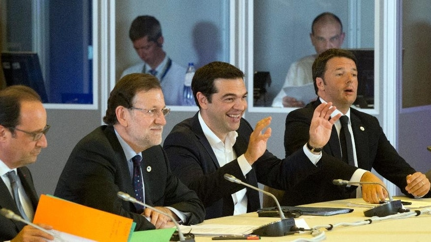 Greek Prime Minister Alexis Tsipras, second left, gestures while speaking during a round table meeting at an emergency summit of eurozone heads of state or government at the EU Council building in Brussels on Tuesday, July 7, 2015. Greek Prime Minister Alexis Tsipras on Tuesday will try to use a resounding referendum victory to eke out concessions from European creditors over a bailout for the crisis-ridden country. From left, French President Francois Hollande, Spanish Prime Minister Mariano Rajoy and Italian Prime Minister Matteo Renzi. (AP Photo/Michel Euler)