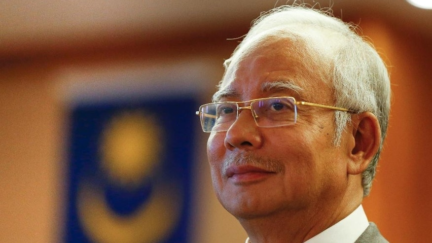 Malaysian Prime Minister Najib Razak pauses during a government event in Putrajaya, Malaysia, Wednesday, July 8, 2015. Malaysian authorities have frozen six bank accounts as part of an investigation into allegations that hundreds of millions of dollars were transferred from a state investment fund to the personal accounts of Najib. (AP Photo/Vincent Thian)