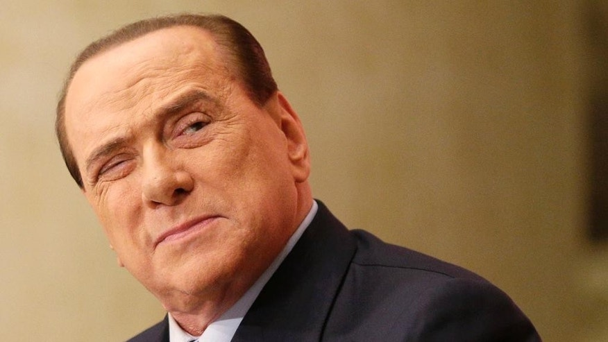 "FILE - In this Dec. 4, 2013 file photo Silvio Berlusconi attends the launch of the book ""Sale, zucchero e caffe'"" (Salt, Sugar and Coffee) by journalist Bruno Vespa, in Rome. A court in Naples on Wednesday, July 8, 2015  was deciding whether to convict former Premier Silvio Berlusconi on charges he bribed a senator to switch sides in Parliament, allegedly to hasten the demise of a coalition government led by chief political rival Romano Prodi. (AP Photo/Alessandra Tarantino, Files)"