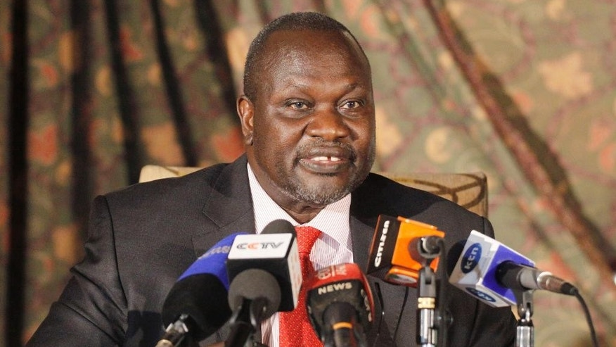 South Sudan rebel leader Riek Machar addresses journalists during a news conference in Nairobi, Kenya , Wednesday, July 8, 2015. Machar called on South Sudan President Salva Kiir to resign along with the whole government or risk sparking a revolution (AP Photo/Khalil Senosi)