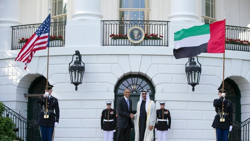 FILE - In this Wednesday, May 13, 2015 file photo, President Barack Obama, left, shakes hands with Sheikh Mohamed bin Zayed Al Nahyan, Crown Prince of Abu Dhabi, Deputy Supreme Commander of the UAE Armed Forces and Chairman of the Executive Council of the Emirate of Abu Dhabi, as he arrives at the South Lawn of the White House in Washington. The U.S. and Emirati governments said they have launched a new digital communications center focused on using social media to counter the Islamic State group's active online propaganda efforts. The new Sawab Center, based in Abu Dhabi, became operational Wednesday, July 8. (AP Photo/Carolyn Kaster, File)