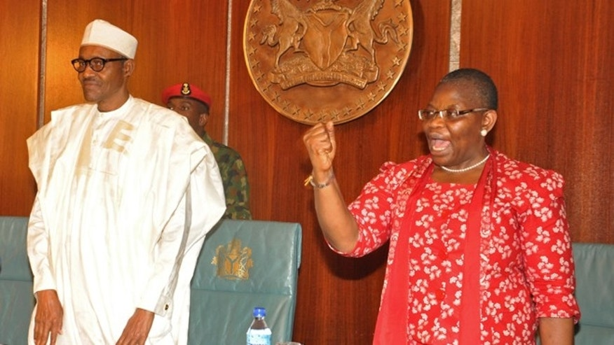 July 8, 2015: Nigerian President Muhammadu Buhari, left, stands next to Oby Ezekwesili, a coordinator of the 'Bring Back Our Girls' campaign that was started after Nigerian extremists abducted girls from a Nigerian school, at the presidential residence in Abuja, Nigeria.