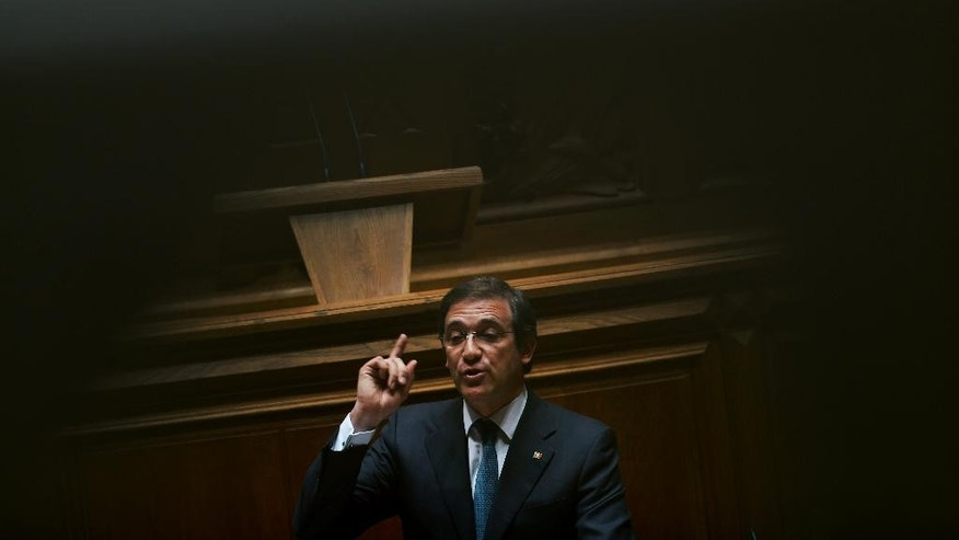In this photo taken on Wednesday, July 8, 2015, Portugal's Prime Minister Pedro Passos Coelho addresses lawmakers during the debate on the state of the nation at the Portuguese parliament, in Lisbon. Eurozone governments taking a tough line on Greece's demand for debt relief fear opening a potentially bigger can of worms in countries like Portugal, which also needed a bailout. A decade of spending more than it earned pushed Portugal close to bankruptcy in 2011. The 78 billion euro bailout loan it got that year was added to its already massive debt pile. (AP Photo/Francisco Seco)