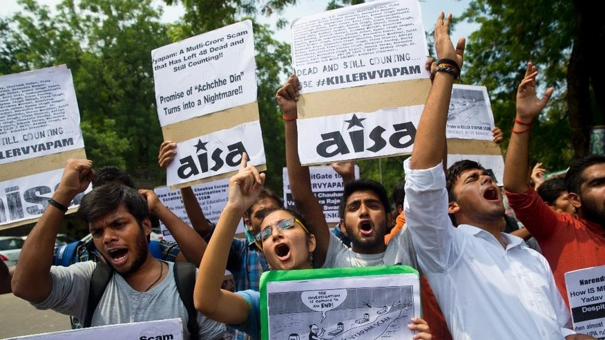 Activists of the left wing, All India Students' Association (AISA), shout slogans against Madhya Pradesh state chief minister Shivraj Singh Chauhan, during a protest against a job scam in the central Indian state in New Delhi, India, Thursday, July 9, 2015. India's top court Thursday ordered a federal investigation into a multimillion-dollar college admission and government job recruitment scandal said to be linked to dozens of mysterious deaths. The Supreme Court ordered the Central Bureau of Investigation, India's FBI, to take over from the state police the investigation into the alleged irregularities in job recruitment and college admissions as well as the deaths of nearly 50 people associated with the scam. (AP Photo/Saurabh Das)z