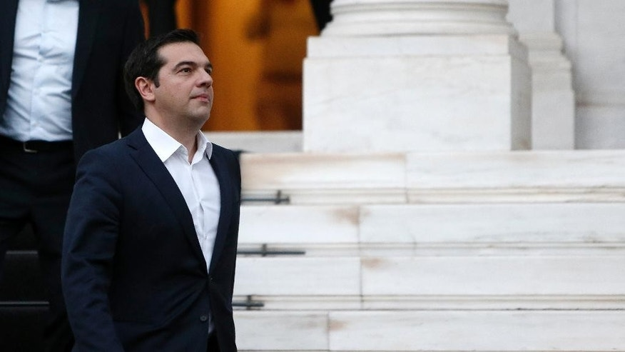 Greece's Prime Minister Alexis Tsipras leaves from Maximos Mansion to meet the Greek President Prokopis Pavlopoulos in Athens, Wednesday, July 8, 2015. Tsipras has stretched his EU partners' patience to the limit with months of missteps and contradictory moves and now, having just four days to save his country from ruin, is finding his list of allies is short. (AP Photo/Petros Karadjias)