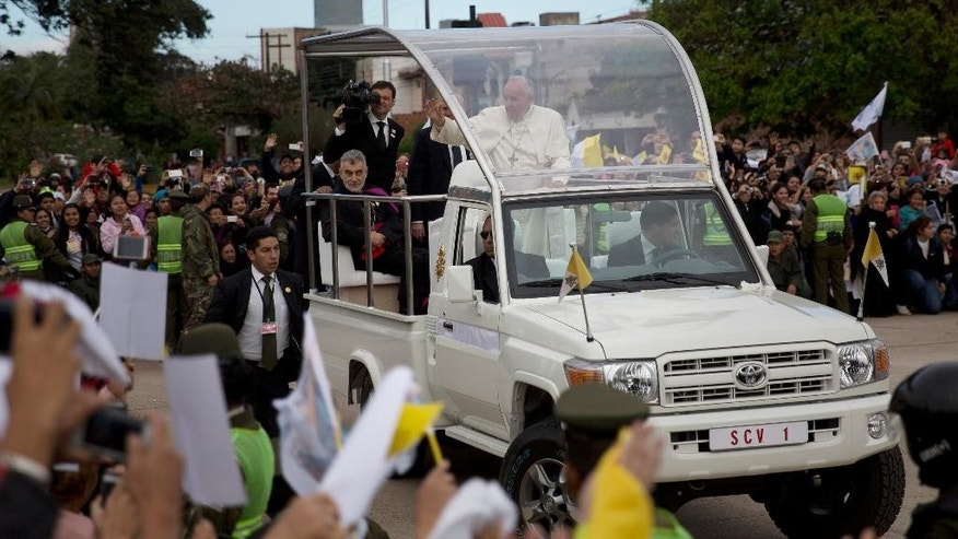 Pope Francis greets the crowd in Santa Cruz, Bolivia, Thursday, July 9, 2015. The pope is heading to his first public event of the day in Bolivia, an open-air Mass in Santa Cruz's Christ the Redeemer square. (AP Photo/Rodrigo Abd)