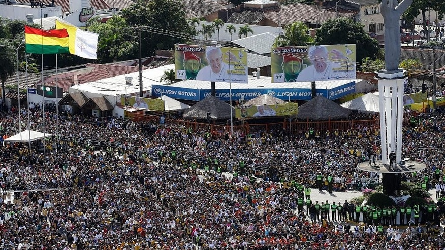 Faithful gather for Mass celebrated by Pope Francis at Christ the Redeemer square in Santa Cruz, Bolivia, Thursday, July 9, 2015. Pope Francis rallied tens of thousands of flag-waving Bolivians during his first public Mass in Bolivia on Thursday, one of the key days of his South American pilgrimage. (AP Photo/Gregorio Borgia)