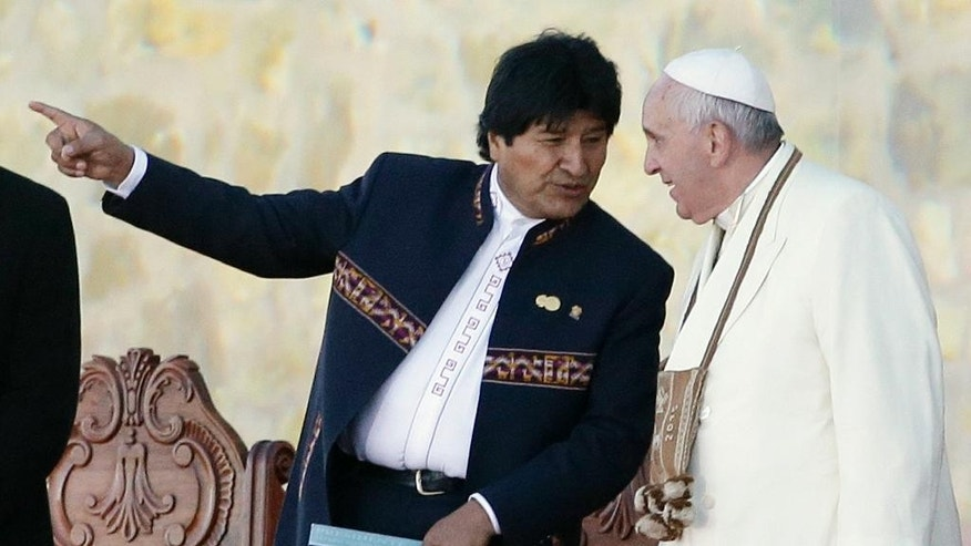 Pope Francis talks with Bolivian President Evo Morales upon his arrival at the El Alto airport, Bolivia, Wednesday, July 8, 2015. Due to the altitude, the pope will spend only a few hours in the capital city La Paz, during his South American tour. Bolivia is the second of three countries Francis will be visiting on his South American tour. (AP Photo/Gregorio Borgia)
