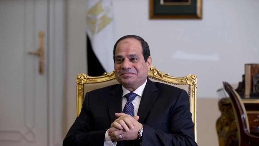 FILE - In this Monday, Oct. 27, 2014 file photo, Egyptian President Abdel-Fattah el-Sissi waits for a meeting with U.S. Treasury Secretary Jack Lew at the presidential palace in Cairo, Egypt. El-Sissi endorsed the law defining voting districts in the country of more than 50 million voters, his spokesman said Thursday, July 9, 2015, removing the last hurdle for a date to be set for the much delayed parliamentary elections. (AP Photo/Hassan Ammar, Pool, File)