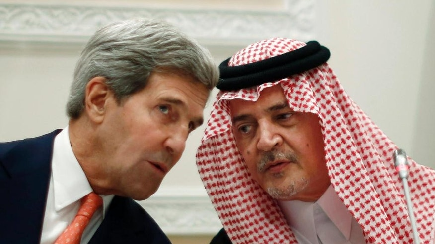 FILE - In this Monday, Nov. 4, 2013 file photo, U.S. Secretary of State John Kerry, left, speaks with Saudi Arabia's Foreign Minister Prince Saud al-Faisal in Riyadh, Saudi Arabia. The country's Foreign Ministry spokesman said Thursday, July 9, 2015, that the prince, who was the world's longest serving foreign minister with 40 years in the post until earlier this year, has died. He was 75. (Jason Reed, Pool Photo via AP, File)