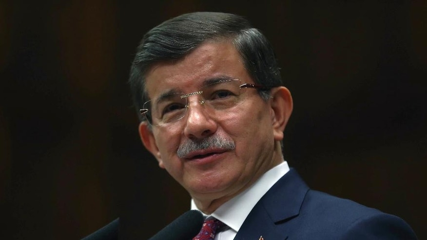 Turkish Prime Minister Ahmet Davutoglu addresses his ruling party lawmakers in Ankara, Turkey, Thursday, July 9, 2015. Davutoglu said that he expects to be given the official mandate to form a new government later in the day. Davutoglu's ruling party won Turkey's general election on June 7 but lost its parliamentary majority, forcing it to seek a coalition partnership with one of three smaller parties in parliament. Davutoglu said President Recep Tayyip Erdogan was likely to task him to form the government on Thursday. He said he would begin coalition-building talks with other party leaders next week.(AP Photo)