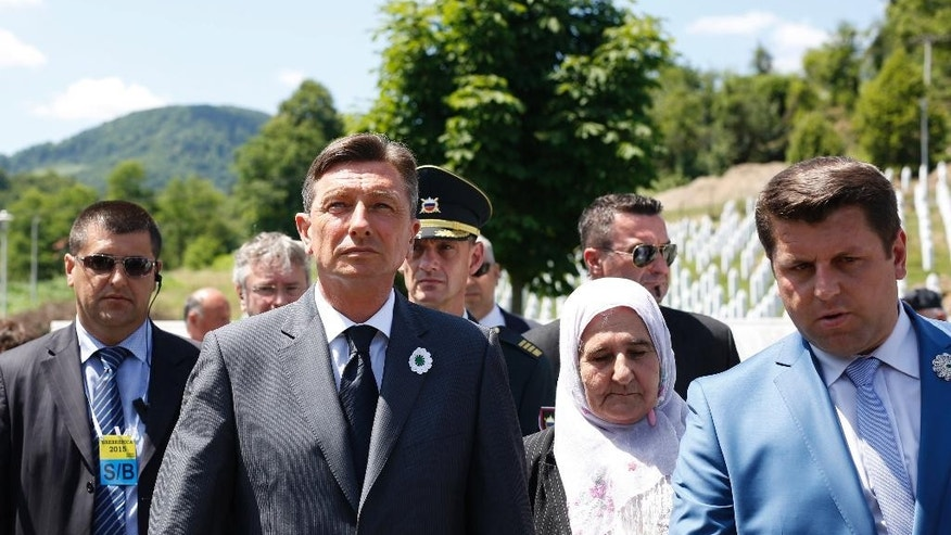 President of  Republic of Slovenia Borut Pahor reacts during visit to the memorial centre of Potocari near Srebrenica, 150 kms north east of Sarajevo, Bosnia, Friday, July 10, 2015. Twenty years ago, on July 11, 1995, Serb troops overran the eastern Bosnian Muslim enclave of Srebrenica and executed some 8,000 Muslim men and boys, which International courts have labeled as an act of genocide, and newly identified victims of the genocide are still being re-interred in Srebrenica.(AP Photo/Amel Emric)