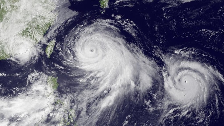 July 9, 2015 - Satellite image shows Tropical Storm Linfa, left, tracking westward parallel to the coast of China, and Typhoon Chan-hom, over the Ryukyu Trench south of Okinawa, Japan, on a track heading northwest toward the China coast north of Wenzhou.