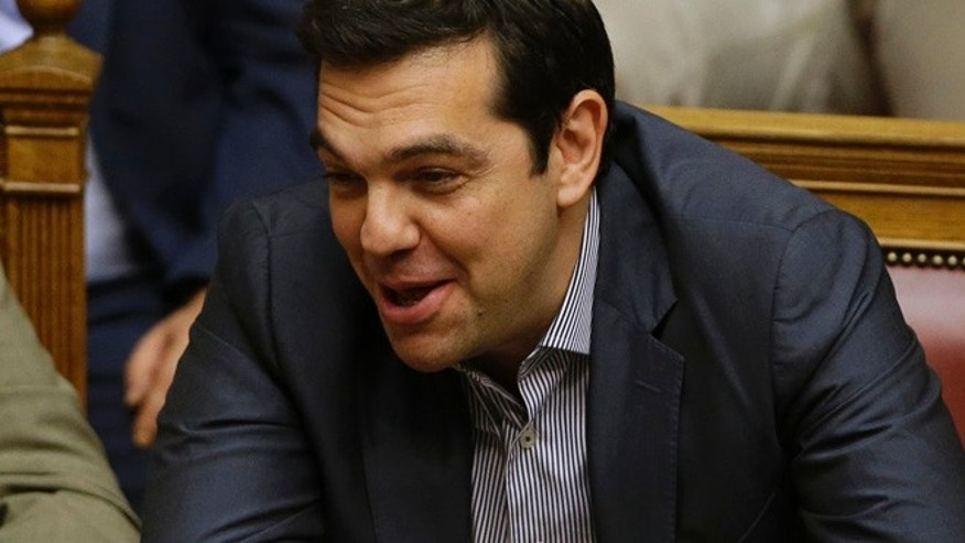 July 11, 2015: Greece's Prime Minister Alexis Tsipras laughs during a parliament meeting in Athens. (AP)