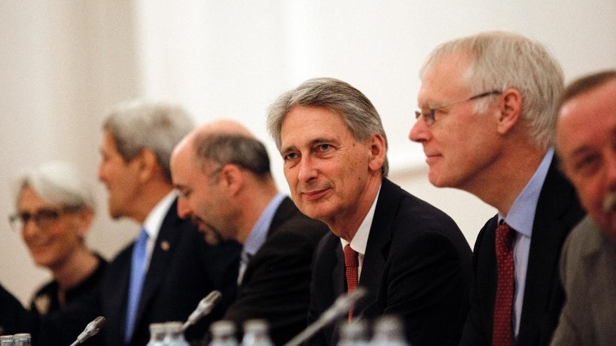 "British Foreign Secretary Philip Hammond, centre, attends a meeting with foreign ministers and representatives of United States, France, Germany, China, Russia and the European Union during the current round of nuclear talks with Iran, being held in Vienna, Austria July 10, 2015.  U.S. Secretary of State John Kerry, 2nd left, and U.S. Under Secretary for Political Affairs Wendy Sherman, left.  U.S. Secretary of State John Kerry urged Iran to make the ""tough political decisions"" needed to reach an agreement but Iranian Foreign Minister Mohammad Javad Zarif accused major powers on Friday of backtracking on previous pledges and throwing up new ""red lines"" at nuclear talks. (Carlos Barria/Pool via AP)"