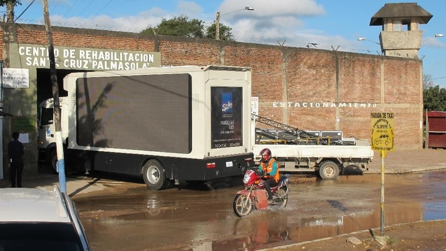 A sound truck attempts to enter the Palmasola prison gate in preparation for a visit by Pope Francis in Santa Cruz, Bolivia, Thursday, July 9, 2015. Francis will visit the prison built to run 800 people but housing 1,500, where two years ago 36 people died in a fierce battle between rival gangs. (AP Photo/Jacobo Garcia)