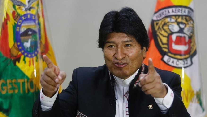 Bolivia's President Evo Morales gives an interview on the sidelines of Pope Francis' visit in Santa Cruz, Bolivia, Friday, July 10, 2015. Morales said he feels like he's got a good friend and ally in the highest of places in his battle for revolutionary social change and halting global warming: Pope Francis. (AP Photo/Juan Karita)
